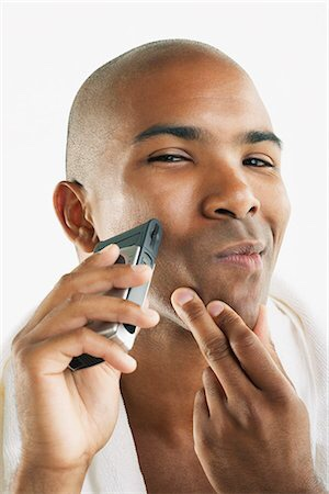 Black man shaving his face