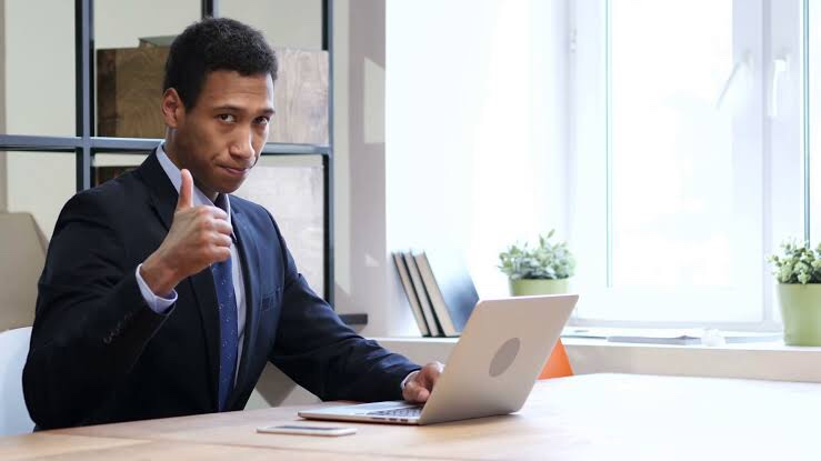 Black man using a laptop and personal branding